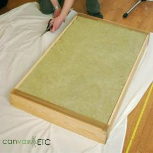 Stretching and stapling acoustic fabric